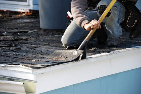 Roofing Professional Repairing Roof in Whitefish, MT